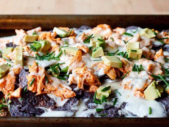 Layered buffalo chicken nachos with creamy gorgonzola sauce